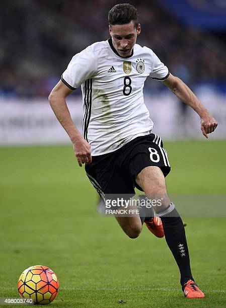 Germany's midfielder Julian Draxler controls the ball during the friendly football match France vs Germany on November 13 2015 at the Stade de France...
