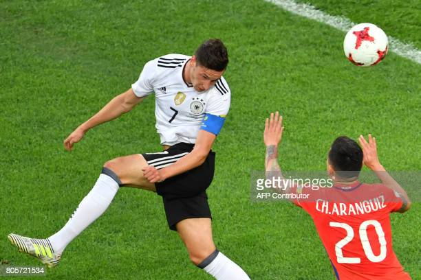Germany's midfielder Julian Draxler heads the ball next to Chile's midfielder Charles Aranguiz during the 2017 Confederations Cup final football...