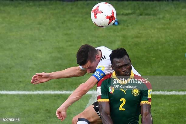 Germany's midfielder Julian Draxler heads the ball with Cameroon's defender Ernest Mabouka during the 2017 FIFA Confederations Cup group B football...