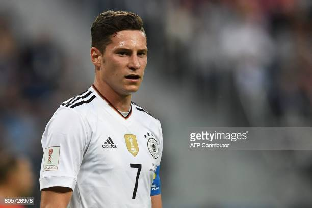 Germany's midfielder Julian Draxler looks on during the 2017 Confederations Cup final football match between Chile and Germany at the Saint...