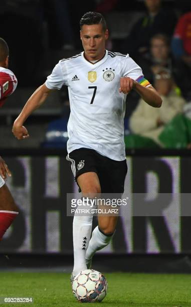 Germany's midfielder Julian Draxler plays the ball during the friendly football match between Denmark and Germany in Brondby Denmark on June 6 2017 /...
