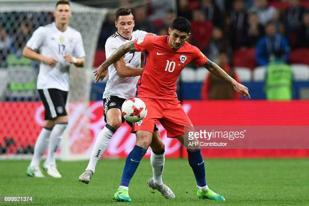 Germany's midfielder Julian Draxler vies with Chile's midfielder Pablo Hernandez during the 2017 Confederations Cup group B football match between...
