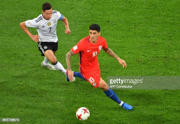 Germany's midfielder Julian Draxler vies with Chile's midfielder Pablo Hernandez during the 2017 Confederations Cup final football match between...