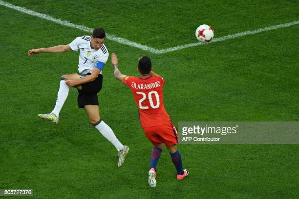 Germany's midfielder Julian Draxler vies with Chile's midfielder Charles Aranguiz during the 2017 Confederations Cup final football match between...
