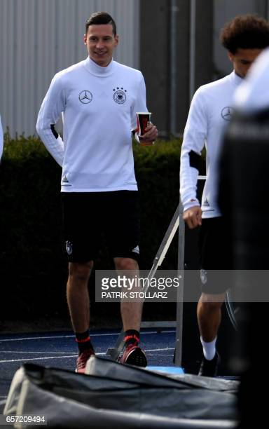 Germany's midfielder Julian Draxler warms up during a training session on march 24 2017 in KamenKaiserau western Germany ahead of the World Cup...