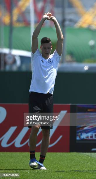 Germany's midfielder Julian Draxler warms up during a training session during the Russia 2017 Confederation Cup football tournament in Sochi on June...