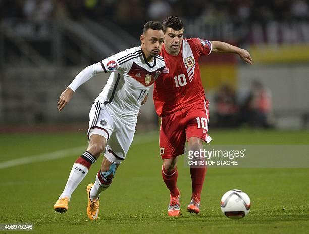 Germany's midfielder Karim Bellarab and Gibraltar's midfielder Liam Walker vie for the ball during the UEFA 2016 European Championship qualifying...