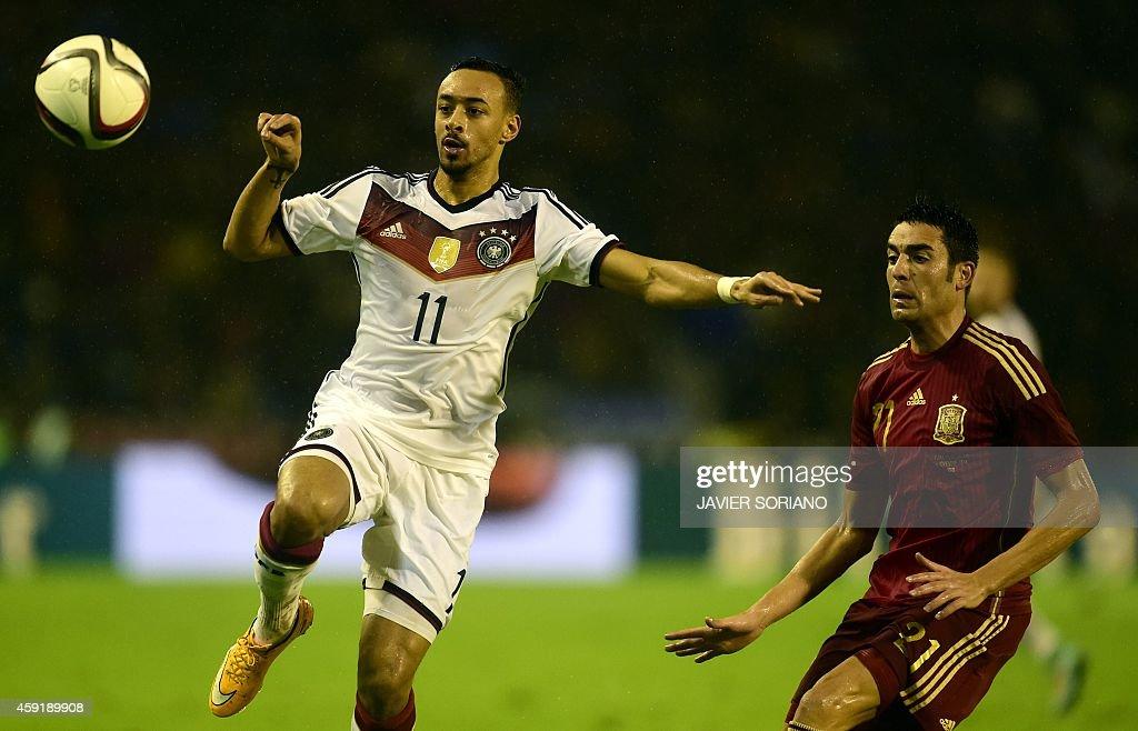 Germany's midfielder Karim Bellarabi vies with Spain's midfielder Bruno Soriano during a friendly football match Spain vs Germany at the Balaidos...