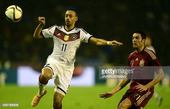 Germany's midfielder Karim Bellarabi vies with Spain's midfielder Bruno Soriano during a friendly football match Spain vs Germany at the Balaidos...