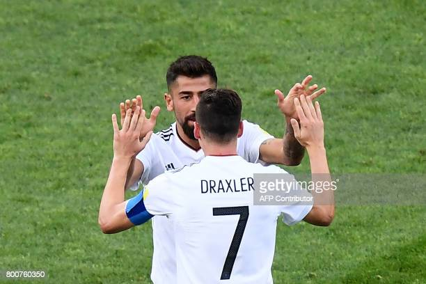 Germany's midfielder Kerem Demirbay celebrates with Germany's midfielder Julian Draxler after scoring a goal during the 2017 FIFA Confederations Cup...