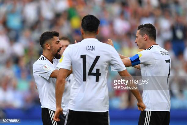 Germany's midfielder Kerem Demirbay celebrates with teammates after scoring a goal during the 2017 FIFA Confederations Cup group B football match...