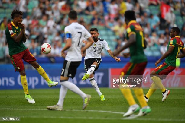 Germany's midfielder Kerem Demirbay kicks the ball to score a goal during the 2017 FIFA Confederations Cup group B football match between Germany and...