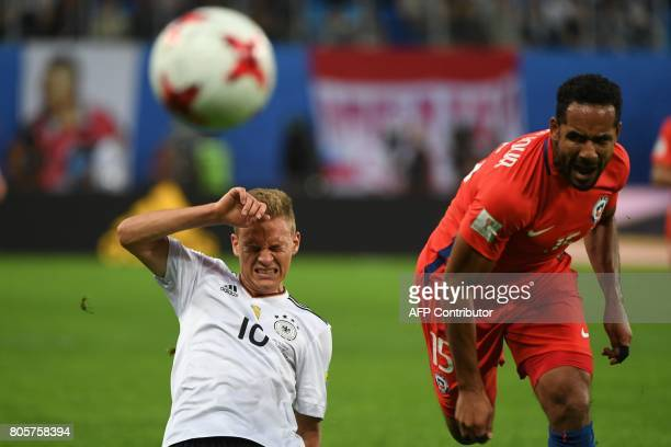 Germany's midfielder Kerem Demirbay vies for the ball against Chile's defender Jean Beausejour during the 2017 Confederations Cup final football...