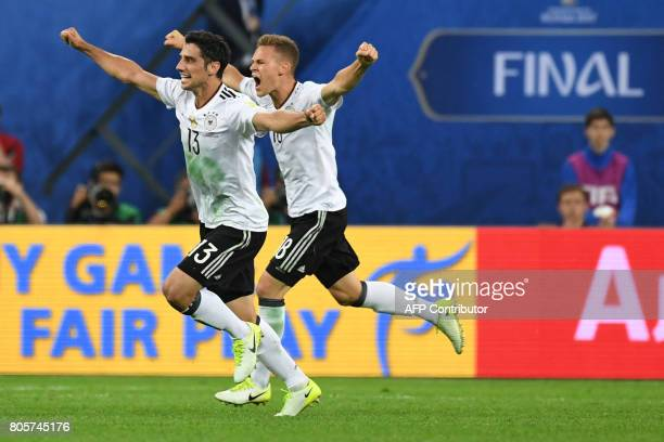 Germany's midfielder Lars Stindl and Germany's defender Joshua Kimmich celebrate winning the 2017 Confederations Cup final football match between...