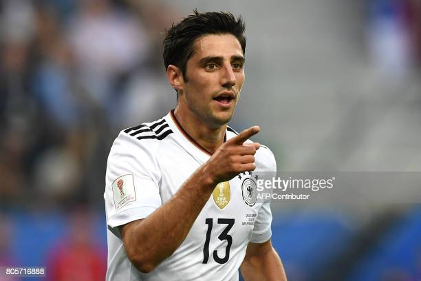 Germany's midfielder Lars Stindl celebrates after scoring the first goal of the match during the 2017 Confederations Cup final football match between...