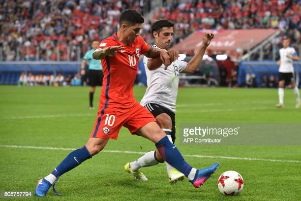 Germany's midfielder Lars Stindl challenges Chile's midfielder Pablo Hernandez during the 2017 Confederations Cup final football match between Chile...