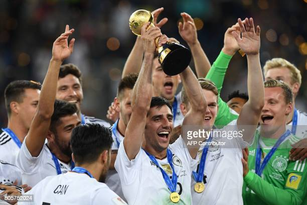 Germany's midfielder Lars Stindl lifts the trophy after winning the 2017 Confederations Cup final football match between Chile and Germany at the...