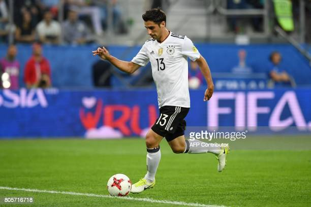 Germany's midfielder Lars Stindl runs with the ball to shoot the first goal of the match during the 2017 Confederations Cup final football match...