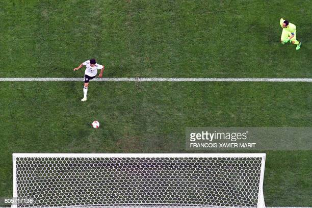 Germany's midfielder Lars Stindl scores his team's first goasl during the 2017 Confederations Cup final football match between Chile and Germany at...