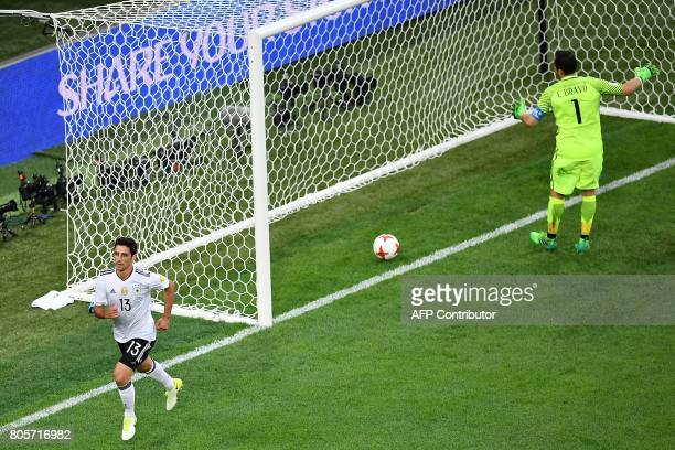 TOPSHOT Germany's midfielder Lars Stindl scores in the nets of Chile's goalkeeper Claudio Bravo during the 2017 Confederations Cup final football...