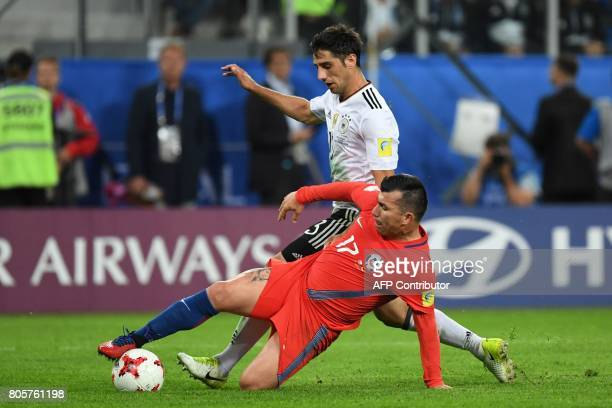 Germany's midfielder Lars Stindl vies with Chile's defender Gary Medel during the 2017 Confederations Cup final football match between Chile and...