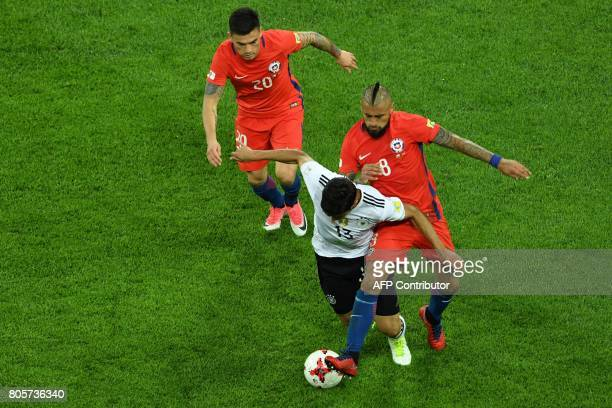 Germany's midfielder Lars Stindl vies with Chile's midfielder Arturo Vidal during the 2017 Confederations Cup final football match between Chile and...