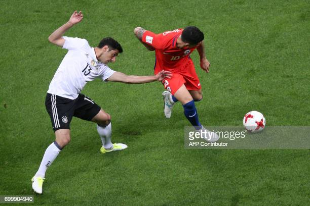 Germany's midfielder Lars Stindl vies with Chile's midfielder Pablo Hernandez during the 2017 Confederations Cup group B football match between...