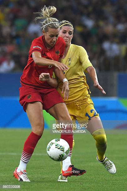 Germany's midfielder Lena Goessling and Sweden's striker Olivia Schough vie for the ball during the Rio 2016 Olympic Games women's football Gold...