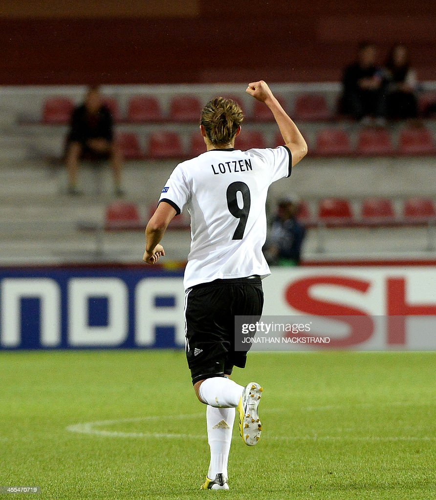 Germany's midfielder Lena Lotzen celebrates after scoring during the UEFA Women's European Championship Euro 2013 group B football match Iceland vs Germany on July 14, 2013 in Vaxjo, Sweden.