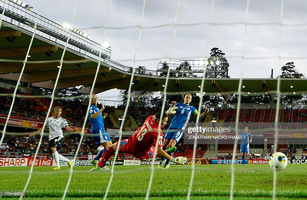Germany's midfielder Lena Lotzen (L) shoots to score past Iceland's goalkeeper Gudbjorg Gunnarsdottir during the UEFA Women's European Championship Euro 2013 group B football match Iceland vs Germany on July 14, 2013 in Vaxjo, Sweden.