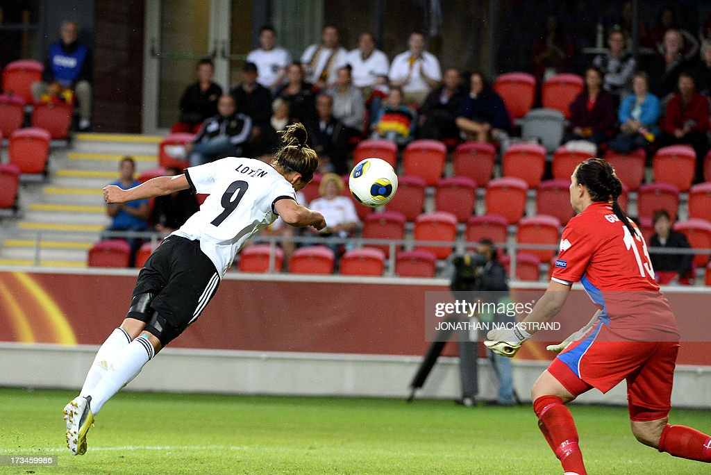 Germany's midfielder Lena Lotzen tries to score past Iceland's goalkeeper Gudbjorg Gunnarsdottir during the UEFA Women's European Championship Euro 2013 group B football match Iceland vs Germany on July 14, 2013 in Vaxjo, Sweden. Germany won 3-0. AFP PHOTO/JONATHAN NACKSTRAND