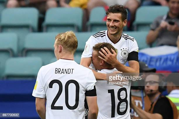 Germany's midfielder Leon Goretzka is congratulated by Germany's defender Joshua Kimmich after he scored a goal during the 2017 Confederations Cup...
