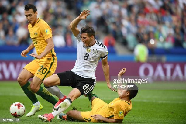 TOPSHOT Germany's midfielder Leon Goretzka is fouled by Australia's midfielder Massimo Luongo to give Germany a penalty shot during the 2017...