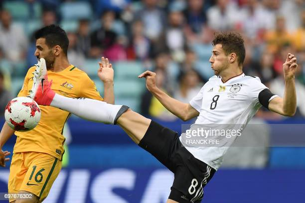 TOPSHOT Germany's midfielder Leon Goretzka jumps to kick the ball past Australia's defender Aziz Behich during the 2017 Confederations Cup group B...
