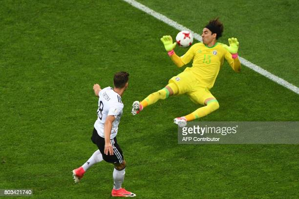 Germany's midfielder Leon Goretzka scores his team's first goal past Mexico's goalkeeper Guillermo Ochoa during the 2017 FIFA Confederations Cup...