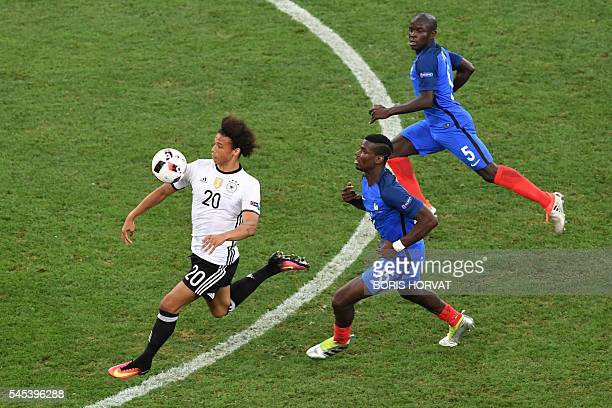 Germany's midfielder Leroy Sane vies for the ball with France's midfielder Paul Pogba and France's midfielder N'Golo Kante during the Euro 2016...