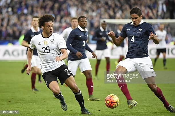 Germany's midfielder Leroy Sane vies with French defender Raphael Varane during a friendly international football match between France and Germany...