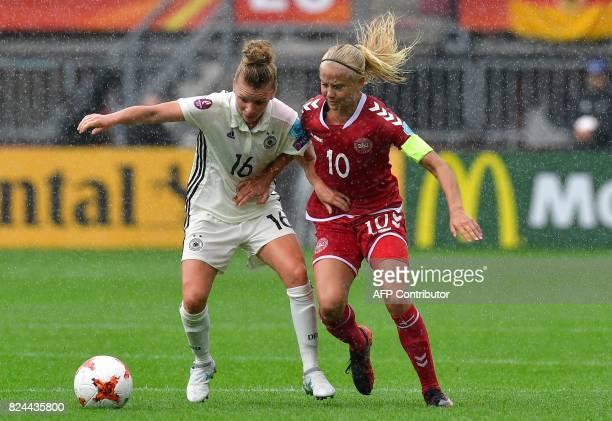 Germany's midfielder Linda Dallmann vies with Denmark's forward and captain Pernille Harder during the quarterfinal UEFA Women's Euro 2017 football...