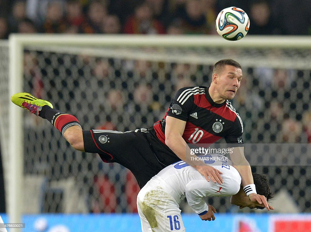 Germany's midfielder Lukas Podolski and Chile's midfielder Felipe Gutierrez vie for the ball during the friendly football match Germany vs Chile in...