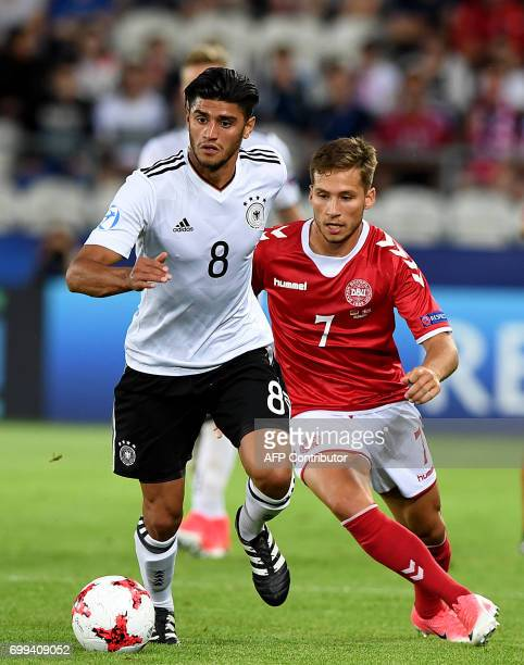 Germany's midfielder Mahmoud Dahoud and Denmark's midfielder Andrew Hjulsager vie for the ball during the UEFA U21 European Championship Group C...