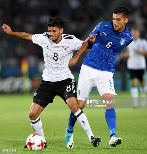 Germany's midfielder Mahmoud Dahoud and Italy's midfielder Lorenzo Pellegrini vie for the ball during the UEFA U21 European Championship Group C...