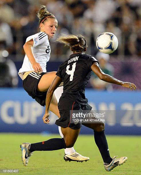Germany's midfielder Malanie Leupolz fights for the ball with US defender Crystal Dunn during the FIFA U20 Women's World Cup Japan final match at the...