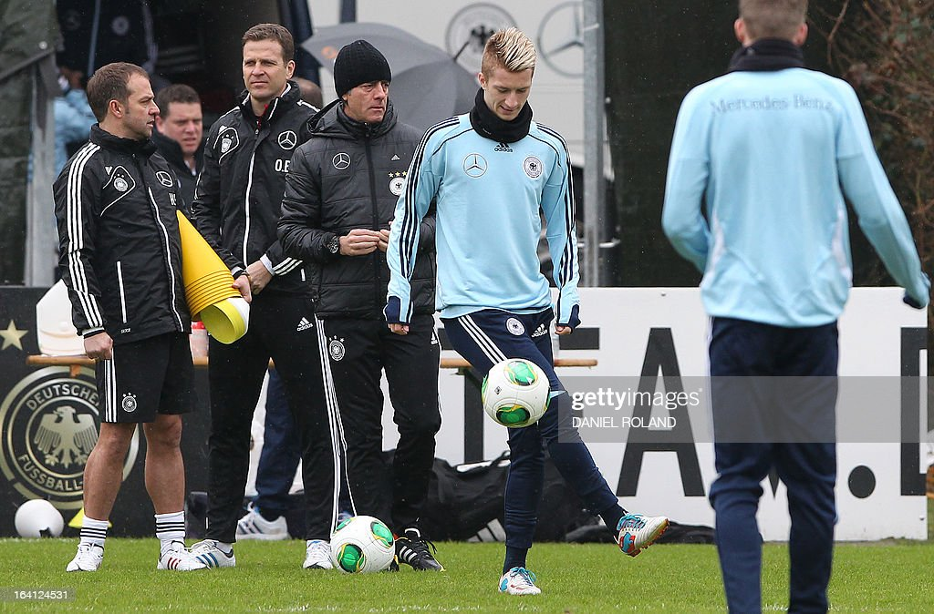 Germany's midfielder Marco Reus (R) and Germany's coach Joachim Loew (3rdL) attend a training session of the German national football team prior to the World Cup qualifier against Kazakhstan in Frankfurt, Germany, on March 20, 2013.