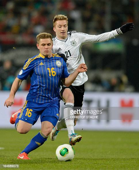 Germany's midfielder Marco Reus and Kazachstan's midfielder Heinrich Schmidtgal vie for the ball during the Germany vs Kazakhstan FIFA 2014 World Cup...