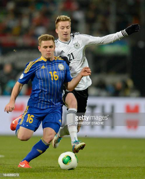 Germany's midfielder Marco Reus and Kazachstan's midfielder Heinrich Schmidtgal vie for the ball during the Germany vs Kazakhstan FIFA 2014 World Cup...