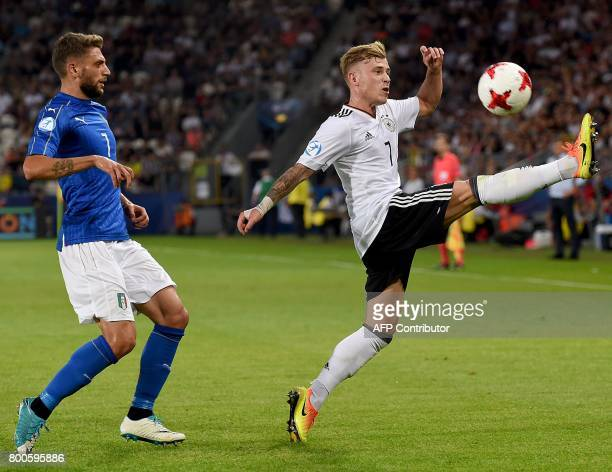 Germany's midfielder Max Meyer and Italy's forward Domenico Berardi vie for the ball during the UEFA U21 European Championship Group C football match...