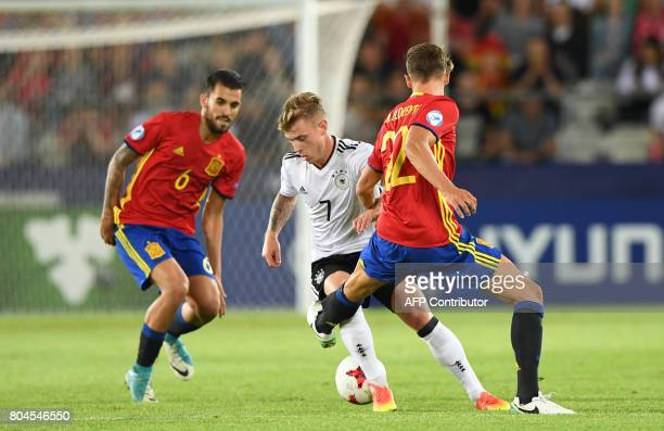 Germany's midfielder Max Meyer and Spain's midfielder Marcos Llorente vie for the ball during the UEFA U21 European Championship football final match...