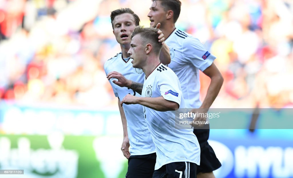 Germany's midfielder Max Meyer (front) celebrates scoring the opening goal with his teammates during the UEFA U-21 European Championship Group C football match Germany v Czech Republic in Tychy, Poland on June 18, 2017. /