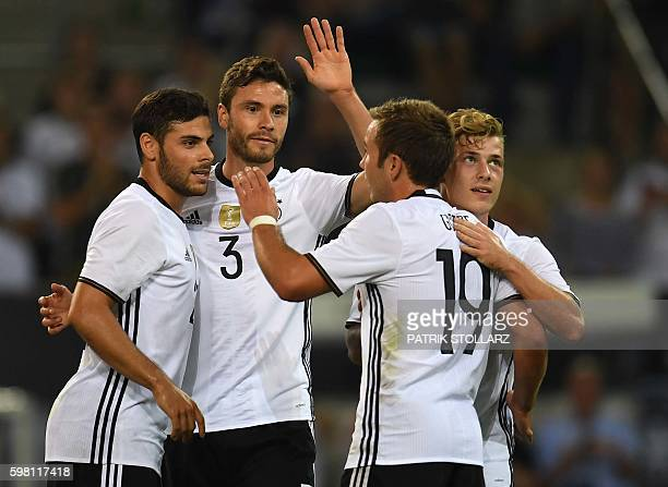 Germany's midfielder Max Meyer celebrates scoring with his teammates during the football friendly match between Germany and Finland in...