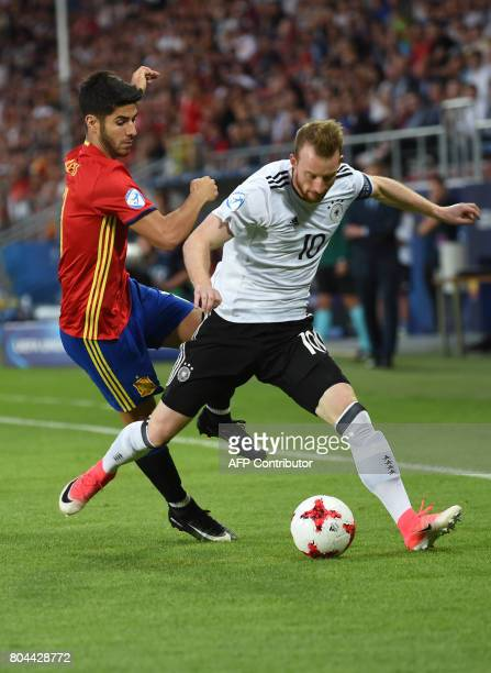 Germany's midfielder Maximilian Arnold vies for the ball with Spain's midfielder Marco Asensio during the UEFA U21 European Championship football...